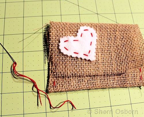 Sew a Felt Heart onto the Burlap Envelope