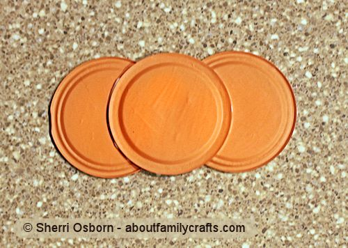 glue together orange canning jar lids