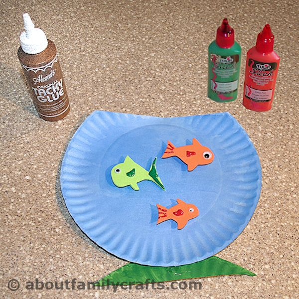 glue fish to the aquarium