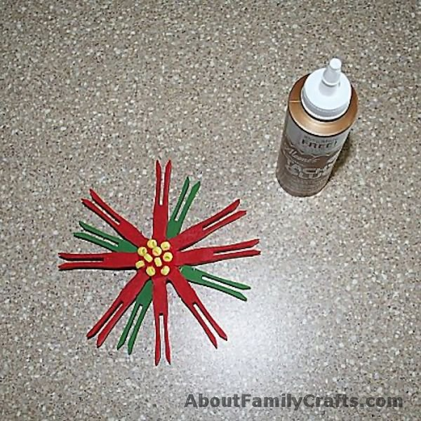 finishing the clothespin poinsettia