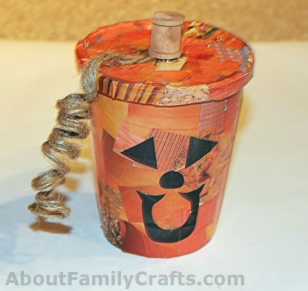 Glue the stem and vine to the pumpkin treat cup