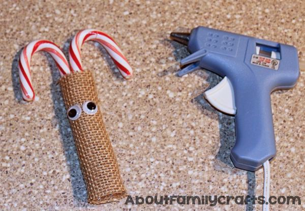 glue eyes onto candy cane reindeer