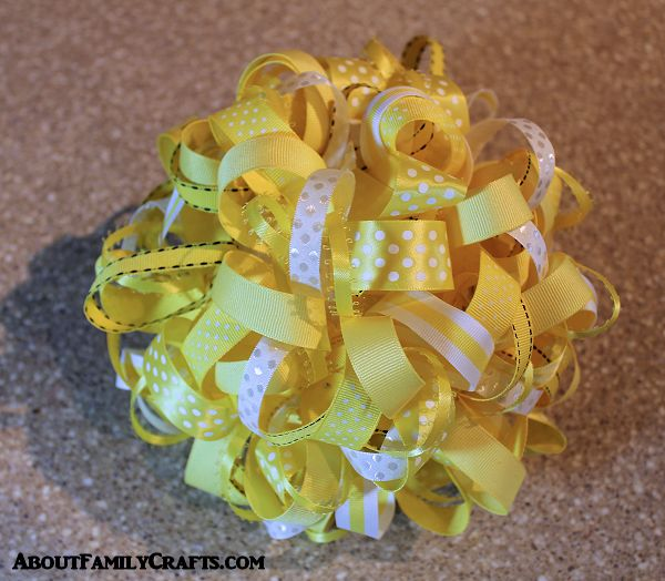 cover the entire styrofoam ball with ribbon loops