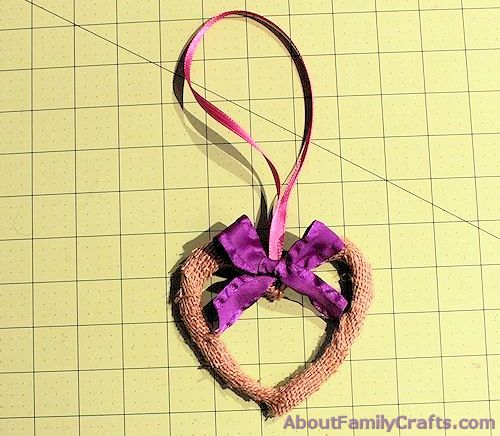 Tie bow onto wire heart