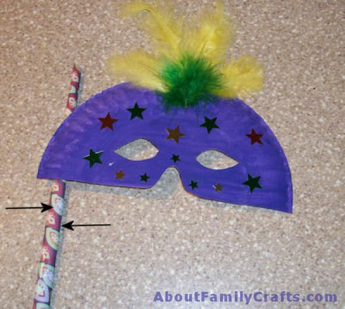 Add a stick to your Mardi Gras Mask