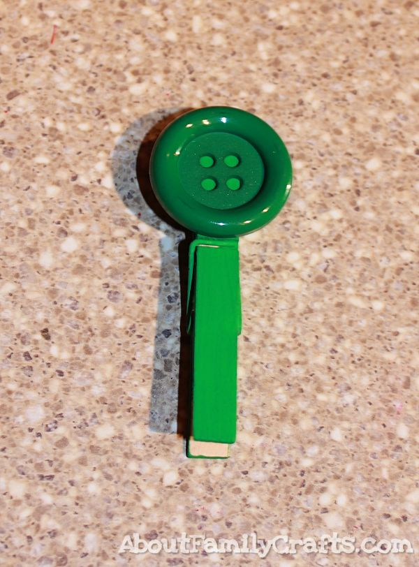 glue button onto clothespin