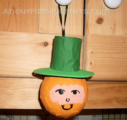How to add loop to paper mache leprechaun