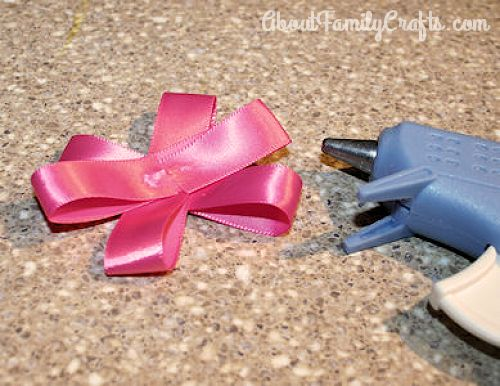 Continue gluing ribbon flower together