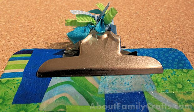 tie ribbon onto clipboard