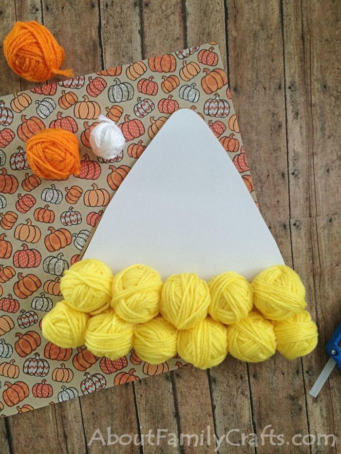 How to start gluing yarn balls onto the candy corn
